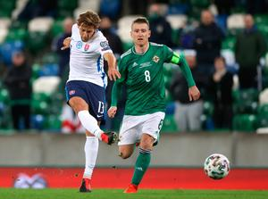 Slovakia's Patrik Hrosovsky (left) and Northern Ireland's Steven Davis battle for the ball during the UEFA Euro 2020 Play-off Finals match at Windsor Park, Belfast. PA Photo. Picture date: Thursday November 12, 2020. See PA story SOCCER N Ireland. Photo credit should read: Liam McBurney/PA Wire.