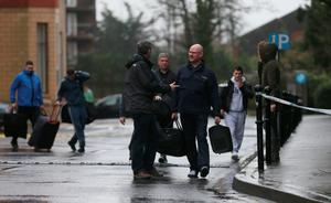 A Garda (centre) speaks to patrons outside the Regency Hotel in Dublin after one man died and two others were injured following a shooting incident at the hotel. PRESS ASSOCIATION Photo. Picture date: Friday February 5, 2016. The attack happened while a boxing tournament weigh-in was going on at the hotel on Swords Road, around three kilometres north of the city centre. See PA story POLICE Shooting. Photo credit should read: Niall Carson/PA Wire
