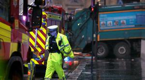 """The scene in Glasgow's George Square after it is understood a bin lorry crashed into a group of pedestrians. PRESS ASSOCIATION Photo. Picture date: Monday December 22, 2014. A Police Scotland spokesman confirmed there is an """"ongoing serious incident"""" in Glasgow's George Square close to Queen Street Station. See PA story POLICE Lorry. Photo credit should read: Danny Lawson/PA Wire PRESS ASSOCIATION Photo. Picture date: Monday December 22, 2014. See PA story POLICE Lorry. Photo credit should read: Danny Lawson/PA Wire"""