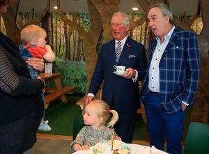 The Prince of Wales meets 9-month-old Margot Dixon, Esme Dixon, 2, and Denis Lynn at the Finnebrogue Artisan event in Downpatrick, Co Down, on the second day of the Royal couple's visit to Northern Ireland.  PRESS ASSOCIATION Photo. Picture date: Wednesday May 22, 2019. See PA story ROYAL Tour. Photo credit should read: Owen Humphreys/PA Wire