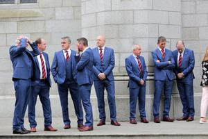 Members from Down GAA wait for the funeral of Newry Businessman Brian Conlon (Photo by Paul McErlane for the Belfast Telegraph)