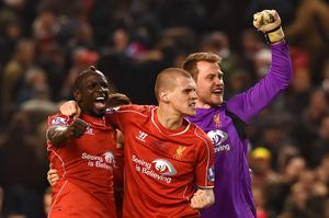 Liverpool's French defender Mamadou Sakho (L), Liverpool's Slovakian defender Martin Skrtel (C) and Liverpool's Belgian goalkeeper Simon Mignolet (R) celebrate their victory after the final whistle
