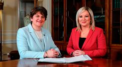 First Minister Arlene Foster of the DUP and (right) Deputy First Minister Michelle O'Neill of Sinn Fein at Stormont