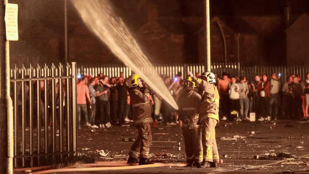Picture - Kevin Scott / Presseye  Belfast - Northern Ireland - Saturday 11th July 2015 -  12th Night Bonfires  Pictured is firefighters using a jet hose on a building at the Sandy Row bonfire in South Belfast, as 12th of July celebrations get under way across Northern Ireland to mark the victory of King William over King James   Picture by Kevin Scott  / Presseye.
