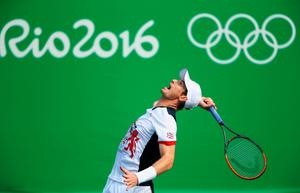 RIO DE JANEIRO, BRAZIL - AUGUST 12:  Andy Murray of Great Britain in action against Steve Johnson of the United States in the Men's Singles Quarterfinal on Day 7 of the Rio 2016 Olympic Games at the Olympic Tennis Centre on August 12, 2016 in Rio de Janeiro, Brazil.  (Photo by Clive Brunskill/Getty Images)