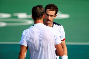 RIO DE JANEIRO, BRAZIL - AUGUST 12:  Andy Murray of Great Britain shakes hands with Steve Johnson of the United States after winning 6-0, 4-6, 7-6 (2) in the Men's Singles Quarterfinal on Day 7 of the Rio 2016 Olympic Games at the Olympic Tennis Centre on August 12, 2016 in Rio de Janeiro, Brazil.  (Photo by Clive Brunskill/Getty Images)