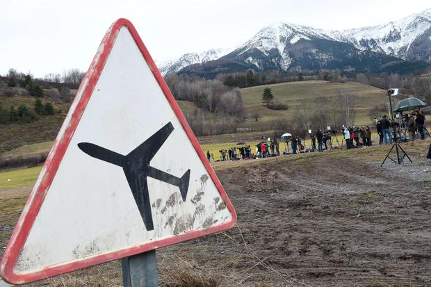 Journalists wait on March 25, 2015 on a air base in Seyne, French Alps a day after a Germanwings Airbus A320 smashed into the French Alps, killing all 150 people on board. Search and rescue operations restarted on Wednesday at the site, helicopters took over from an improvised base, heading for the remote area of the Alps where the plane crashed. AFP PHOTO/BORIS HORVATBORIS HORVAT/AFP/Getty Images