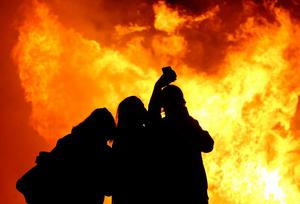 11th July 2015   ?William Cherry/Presseye  A group of women take a selfie as the Ballymacash bonfire burns in Lisburn for the 11th of July Celebrations when the bonfires are lit in many Protestant, unionist and loyalist areas of Northern Ireland.