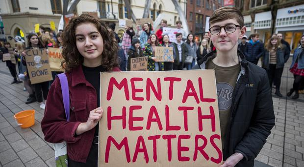Lamees Shaath 15, and Euan Gepp 15 Newtownabbey at Cornmarket in Belfast to raise awareness of the Mental Health crisis in Northern Ireland
