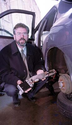 PACEMAKER BELFAST 9/12/99 Sinn Fein leader Gerry Adams pictured with the Ford Mondeo and Bugging device which he claims were planted by British Intellegance officers as he and Martin McGuniiess were having meeting with the IRA during the Mitchell review.