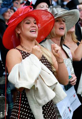 ASCOT, ENGLAND - JUNE 20:  Racegoers enjoy the atmosphere as they attend Ladies' Day on day three of Royal Ascot at Ascot Racecourse on June 20, 2013 in Ascot, England.  (Photo by Chris Jackson/Getty Images for Ascot Racecourse)