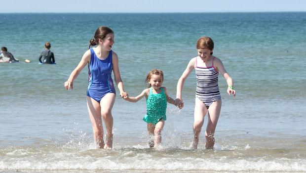 Press Eye - Weather Pictures - Portstewart Beach - 30th June 2018  Photograph by Declan Roughan  (L-R) Anna Mc Cavana aged 11, Sarah Gaw aged 3 and Catherine Gaw aged 11 all from Randalstown.