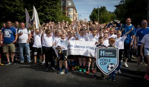 Some of the young footballers from Oxford United Stars pictured during Tuesday's Hughes Insurance Foyle Cup parade in Derry.