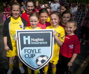 Some of the young ladies taking part in Tuesday's Hughes Insurance Foyle Cup parade as it made its way down Northland Road.