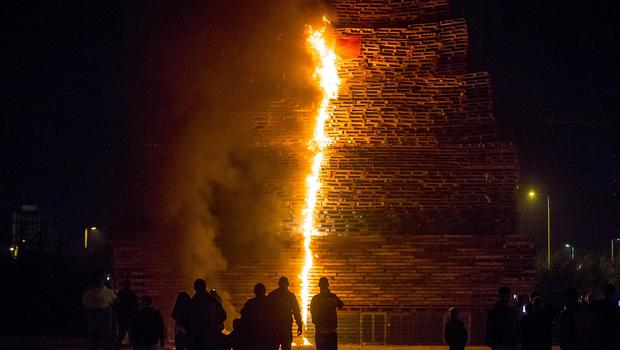 The 'eleventh nightÕ bonfire is lit at the Milner Street area of the Village in South Belfast as celebrations of William of Orange's victory commence on July 11th 2017 (Photo by Kevin Scott / Belfast Telegraph)