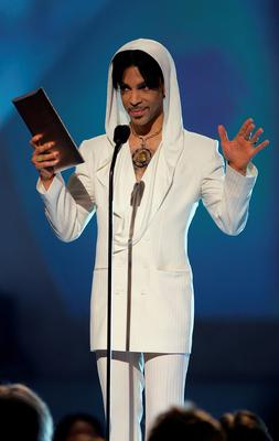 "FILE - 21 APRIL 2016: Musician Prince has reportedly Died at 57 on April 21, 2016. PASADENA, CA - JANUARY 9:  Musician Prince presents the award for ""Favorite Leading Lady"" onstage during the 31st Annual People's Choice Awards at the Pasadena Civic Auditorium on January 9, 2005 in Pasadena, California. (Photo by Frank Micelotta/Getty Images)"