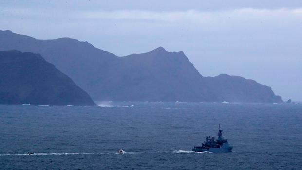 An Irish Naval ship and specialist boats near to Blacksod Lighthouse, Co. Mayo, Ireland, as the search continues for an Irish Coast Guard helicopter which went missing off the west coast of Ireland. PA
