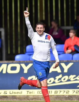 It's my goal, I swear: Linfield's Mark Haughey celebrates after his effort goes in via a deflection.