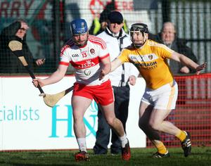 Moving forward: Neal McAuley (right) knows Antrim have underperformed this season and is aiming to put that right in the Christy Ring Cup