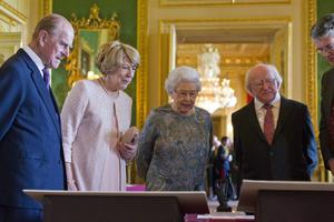 WINDSOR, ENGLAND - APRIL 08:  Queen Elizabeth II (3rd L) shows Irish President Michael D Higgins (2nd R), his wife Sabina Coyne (2nd L) and Prince Philip, Duke of Edinburgh (L), Irish related items from the Royal Collection, in the Green Drawing Room at Windsor Castle on April 8, 2014 in Windsor, England. This is the first official visit by the head of state of the Irish Republic to the United Kingdom.  (Photo by Justin Tallis - WPA Pool/Getty Images)