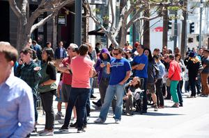 Customers wait in line to put a USD 1,000 deposit on the as yet unseen Tesla Model 3, outside the Tesla store on the Third Street Promenade in Santa Monica, California, on March 31, 2016. AFP/Getty Images