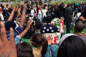 BALTIMORE, MD - APRIL 27:  Friends and relatives say their last goodbyes to Freddie Gray during his graveside service at the Woodland Cemetery April 27, 2015 in Baltimore, Maryland. Gray, 25, was arrested for possessing a switch blade knife April 12 outside the Gilmor Homes housing project on Baltimore's west side. According to his attorney, Gray died a week later in the hospital from a severe spinal cord injury he received while in police custody.  (Photo by Chip Somodevilla/Getty Images)