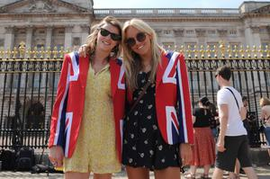 Royal well wishers Sarah Haggie (left) and Fi Thompson (right) pose in Union flag themed jackets outside Buckingham Palace in central London, as the Duchess of Cambridge was admitted to hospital in the early stages of labour. Anthony Devlin/PA Wire