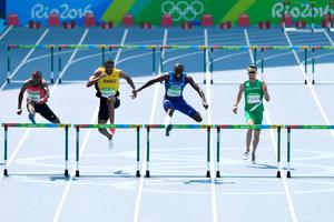 RIO DE JANEIRO, BRAZIL - AUGUST 18:  Kerron Clement of the United States leads Annsert Whyte of Jamaica and Thomas Barr of Ireland during the Men's 400m Hurdles Final on Day 13 of the Rio 2016 Olympic Games at the Olympic Stadium on August 18, 2016 in Rio de Janeiro, Brazil.  (Photo by Shaun Botterill/Getty Images) *** BESTPIX ***
