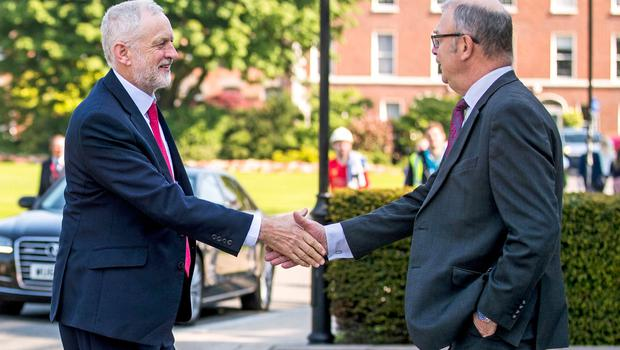 Labour leader Jeremy Corbyn is greeted by Professor James McElnay, Acting Vice-Chancellor at Queen's University in Belfast, ahead of delivering a public lecture in the Great Hall. PRESS ASSOCIATION Photo. Picture date: Thursday May 24, 2018. Mr Corbyn urged Prime Minister Theresa May to reconvene the British Irish Intergovernmental Conference, a body that offers the Irish a consultative role in non-devolved matters concerning Northern Ireland. See PA story ULSTER Corbyn. Photo credit should read: Liam McBurney/PA Wire