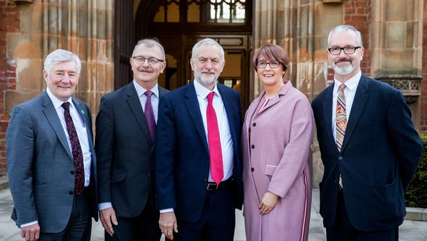 Labour leader Jeremy Corbyn (centre) and Shadow Secretary of State for Northern Ireland Tony Lloyd MP (left) with Acting Vice-Chancellor Professor James McElnay (second from right), Pro-Vice-Chancellor for Internationalisation and Engagement at QueenÕs University Professor Richard English (right), and Acting Registrar Wendy Galbraith at Queens University in Belfast where Corbyn is due to deliver a lecture during his first visit to Northern Ireland as party leader.  PRESS ASSOCIATION Photo. Picture date: Thursday May 24, 2018. Mr Corbyn urged Prime Minister Theresa May to reconvene the British Irish Intergovernmental Conference - a body that offers the Irish a consultative role in non-devolved matters concerning Northern Ireland. See PA story ULSTER Corbyn. Photo credit should read: Liam McBurney/PA Wire