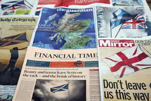 LONDON, SCOTLAND - SEPTEMBER 18:  (EDITORS NOTE: THIS IS A PHOTO ILLUSTRATION) A selection of the British National Newspaper front pages are displayed on September 18, 2014 in London, England. After many months of campaigning the people of Scotland today head to the polls to decide the fate of their country. The referendum is too close to call but a Yes vote would see the break-up of the United Kingdom and Scotland would stand as an independent country for the first time since the formation of the Union.  (Photo by Dan Kitwood/Getty Images)