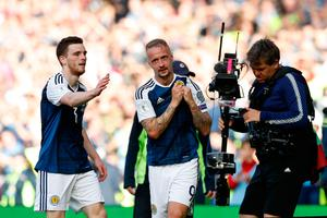 Glee for Leigh: Scotland's two-goal hero Leigh Griffiths will go down in folklore as will Craig Gordon too. Photo: Martin Rickett/PA