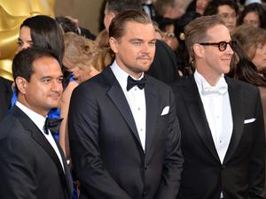 HOLLYWOOD, CA - MARCH 02:  (L-R) Producer Riza Aziz, actor Leonardo DiCaprio, and producer Joey McFarland attend the Oscars held at Hollywood & Highland Center on March 2, 2014 in Hollywood, California.  (Photo by Michael Buckner/Getty Images)