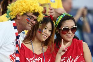 CUIABA, BRAZIL - JUNE 17: South Korea fans enjoy the atmosphere during the 2014 FIFA World Cup Brazil Group H match between Russia and South Korea at Arena Pantanal on June 17, 2014 in Cuiaba, Brazil.  (Photo by Adam Pretty/Getty Images)