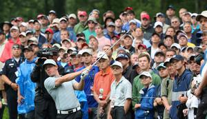 LOUISVILLE, KY - AUGUST 08:  Rory McIlroy of Northern Ireland hts a shot from the rough on the 12th hole during the weather-delayed second round of the 96th PGA Championship at Valhalla Golf Club on August 8, 2014 in Louisville, Kentucky.  (Photo by Andrew Redington/Getty Images)