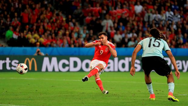Wales' Hal Robson-Kanu (left) scores his side's second goal of the game during the UEFA Euro 2016, quarter final match at the Stade Pierre Mauroy, Lille. PRESS ASSOCIATION Photo. Picture date: Friday July 1 2016. See PA story SOCCER Wales. Photo credit should read: Mike Egerton/PA Wire. RESTRICTIONS: Use subject to restrictions. Editorial use only. Book and magazine sales permitted providing not solely devoted to any one team/player/match. No commercial use. Call +44 (0)1158 447447 for further information.