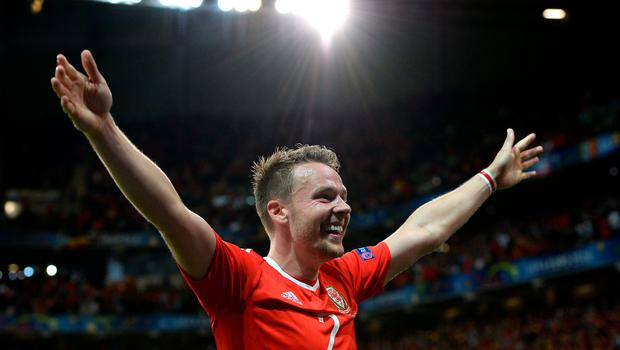 Wales' Chris Gunter celebrates his side's second goal of the game scored by Wales' Hal Robson-Kanu (not in picture) during the UEFA Euro 2016, quarter final match at the Stade Pierre Mauroy, Lille. PRESS ASSOCIATION Photo. Picture date: Friday July 1 2016. See PA story SOCCER Wales. Photo credit should read: Joe Giddens/PA Wire. RESTRICTIONS: Use subject to restrictions. Editorial use only. Book and magazine sales permitted providing not solely devoted to any one team/player/match. No commercial use. Call +44 (0)1158 447447 for further information.