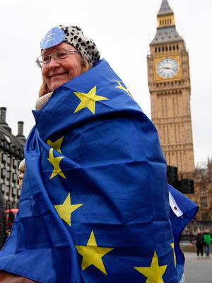LONDON, ENGLAND - MARCH 29:  A protester wears a European Union flag as she takes part in a demonstration near parliament on March 29, 2017 in London, England. Later today British Prime Minister Theresa May will address the Houses of Parliament as Article 50 is triggered and the process that will take Britain out of the European Union will begin.  (Photo by Carl Court/Getty Images)