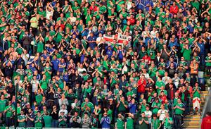 Northern Ireland's fans celebrate the second goal against Belarus during an international friendly football match between Northern Ireland and Belarus at Windsor Park in Belfast, Northern Ireland, on May 27, 2016. / AFP PHOTO / PAUL FAITHPAUL FAITH/AFP/Getty Images