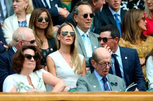 Rory McIlroy (right), Erica Stoll and Rod Laver in the royal box on centre court on day nine of the Wimbledon Championships