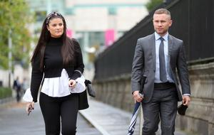 Former boxing world champion Carl Frampton and his wife Christine arrive at Belfast High Court.