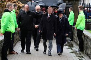 Sir Bobby Charlton and wife Norma arrive for the funeral of former Manchester United and Northern Ireland goalkeeper Harry Gregg, at St Patrick's Parsh Church, Coleraine. PA Photo. Picture date: Friday February 21, 2020. See PA story FUNERAL Gregg. Photo credit should read: Brian Lawless/PA Wire