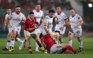 28 October 2016 - Picture by Darren Kidd / Press Eye.     Ulster v Munster at Kingspan Stadium, Belfast.  Ulster's Clive Ross is tackled by Munster's  Rory Scannell and Niall Scannell