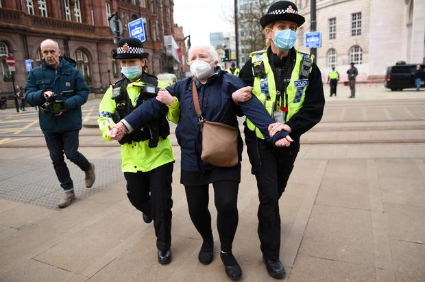 Police detain an NHS worker after breaking up a protest in Manchester over the proposed 1% pay rise for NHS workers from the Government (Jacob King/PA)