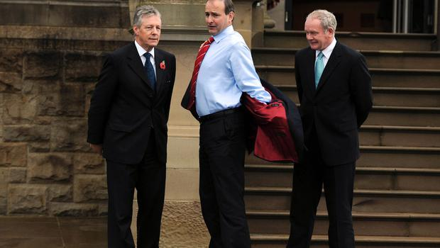 PACEMAKER PRESS INTL BELFAST 11/11/2009. First Minister Peter Robinson and Deputy First Minister Martin McGuinness greet Irish Foreign Secretary Micheal Martin at Stormont castle this morning. Picture Charles McQuillan/Pacemaker.