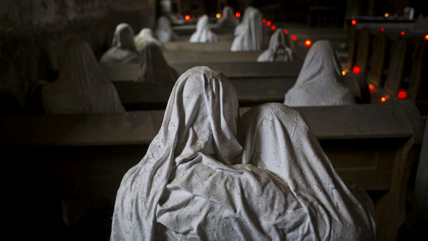 Ghost statues by artist Jakub Hadrava are placed at the St. George's church near Plzen on November 16, 2014 in Lukova, Czech Republic. Artist Jakub Hadrava created 32 plaster life-size ghost statues, which symbolize Sudeten Germans who lived in the village. (Photo by Matej Divizna/Getty Images)