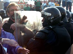 PACEMAKER, BELFAST, 12/7/2005:  Sinn Fein leader Gerry Adams gets pushed by riot police as protesters trying to stop Orange parade on the Crumlin road. PICTURE BY STEPHEN DAVISON