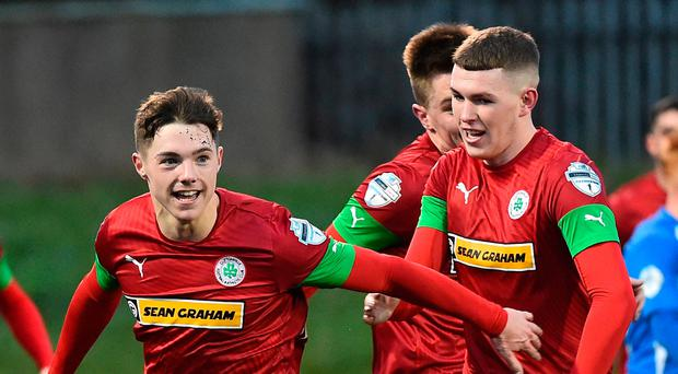 Red for danger: Thomas Maguire hits the winner against Glenavon at Solitude