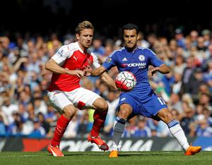 Chelsea's Spanish midfielder Pedro (R) vies with Arsenal's Spanish defender Nacho Monreal (L) during the English Premier League football match between Chelsea and Arsenal at Stamford Bridge in London on September 19, 2015. Chelsea won the game 2-0. AFP PHOTO / IAN KINGTON  RESTRICTED TO EDITORIAL USE. No use with unauthorized audio, video, data, fixture lists, club/league logos or 'live' services. Online in-match use limited to 75 images, no video emulation. No use in betting, games or single club/league/player publications.IAN KINGTON/AFP/Getty Images