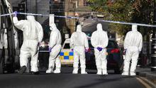 Forensic experts combing Shipquay Street in Londonderry for clues into the killing of Barry McCrory